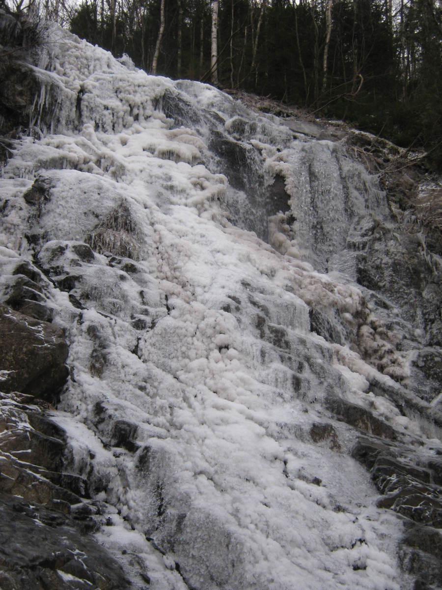 A frozen waterfall near the upper portion of the slide.