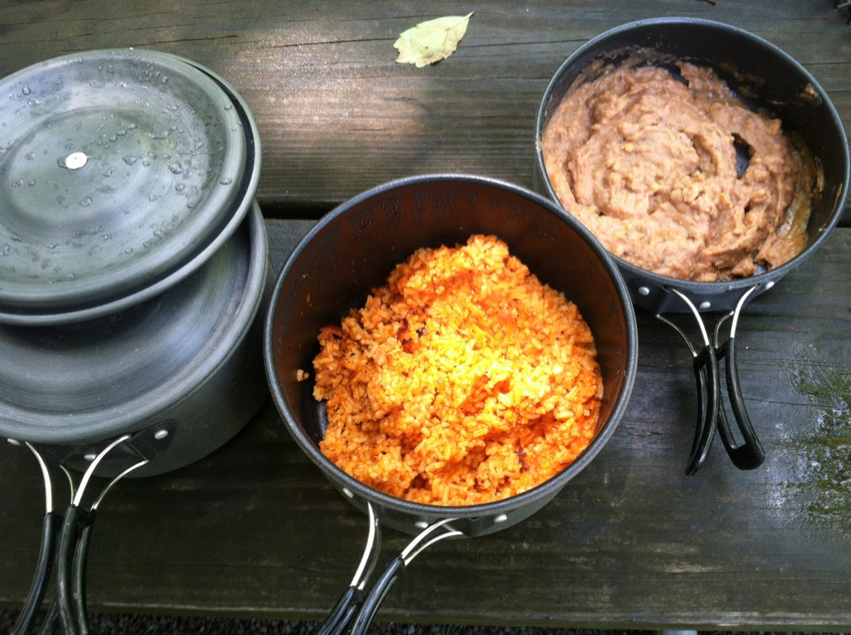Beans and Mexican rice cooked in camping pots