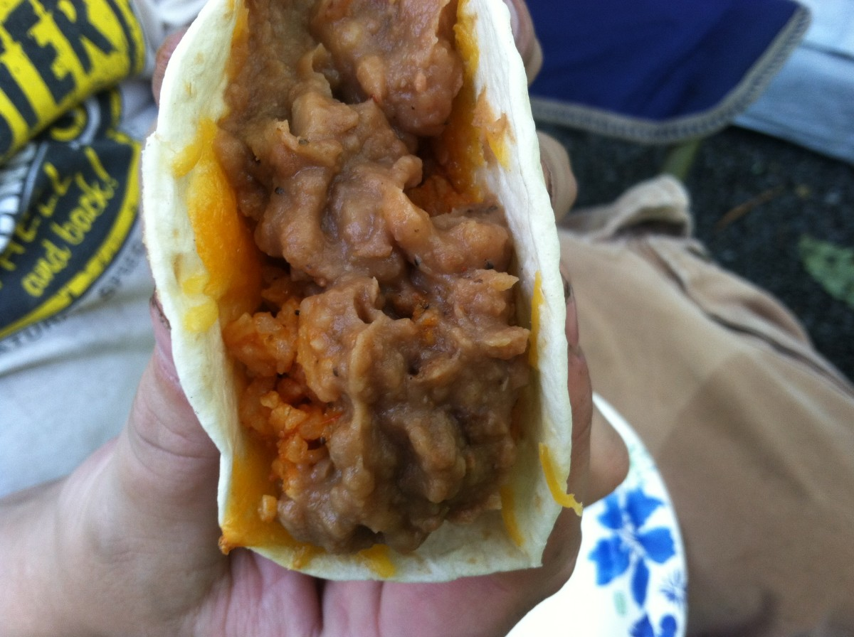 A vegetarian taco with beans and rice