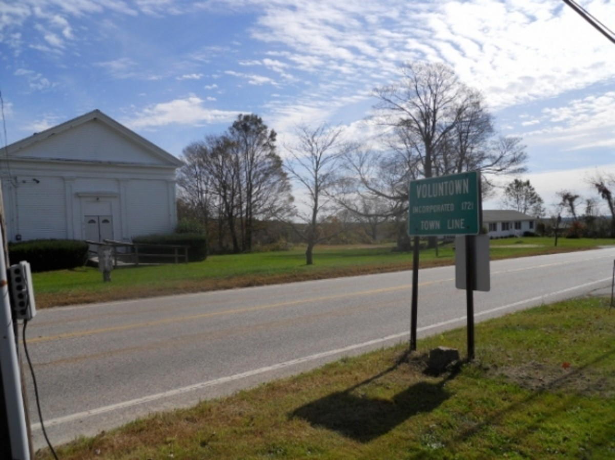 "The entering Voluntown sign as you head south on Route 49 from Sterling.   The ""Line Church"" is across the street."