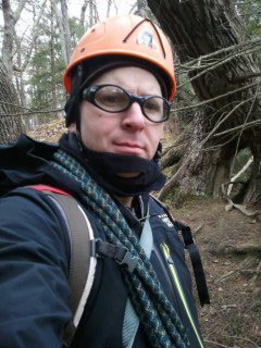 Wear eye protection to protect your eyes while night hiking, but you could probably skip the helmet.