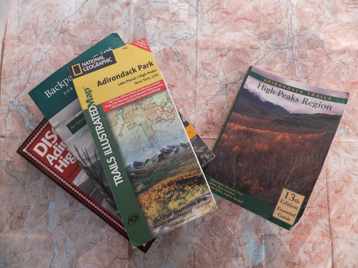 Guidebooks and maps are essential for planning any hiking excursion.