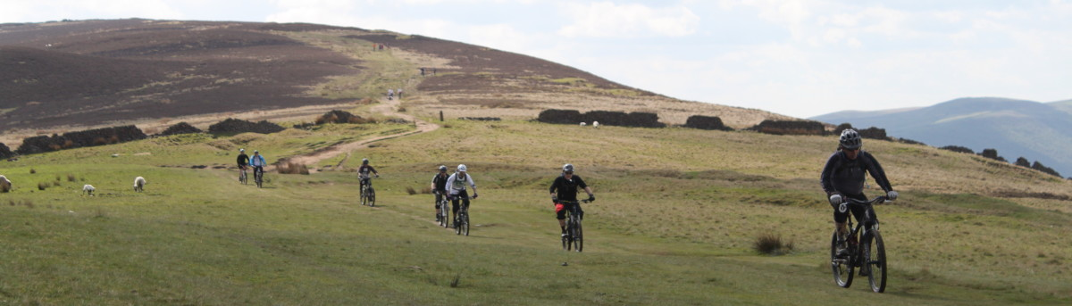 Cycling related testis pain can be a problem, but with a little adjustment it usually can be resolved. (Featured- Riders at Losehill in the Peak District)