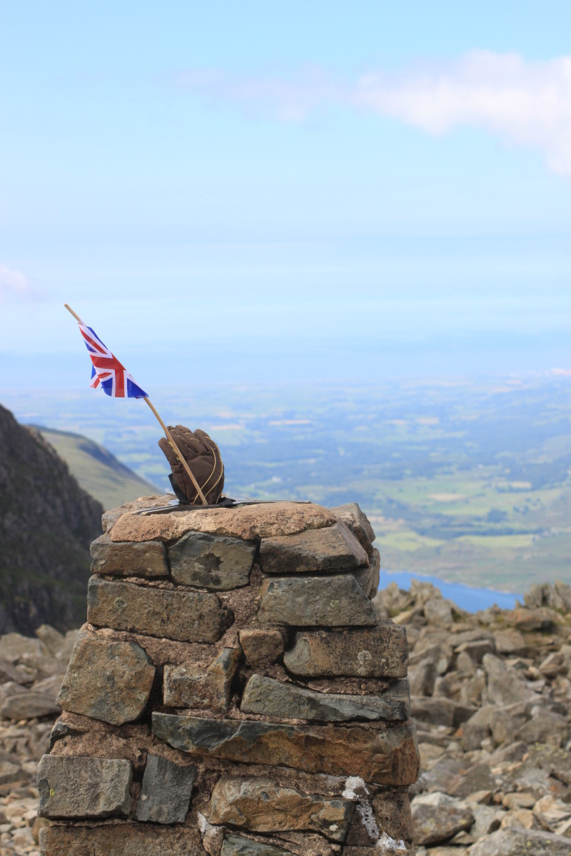 Looking out from the trip point at the to of Scafell Pike with a fitting Union Jack