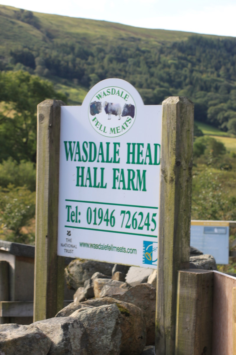 The sign for Wasdale Head Hall Farm is beside the access to the Wasdale National Trust car park