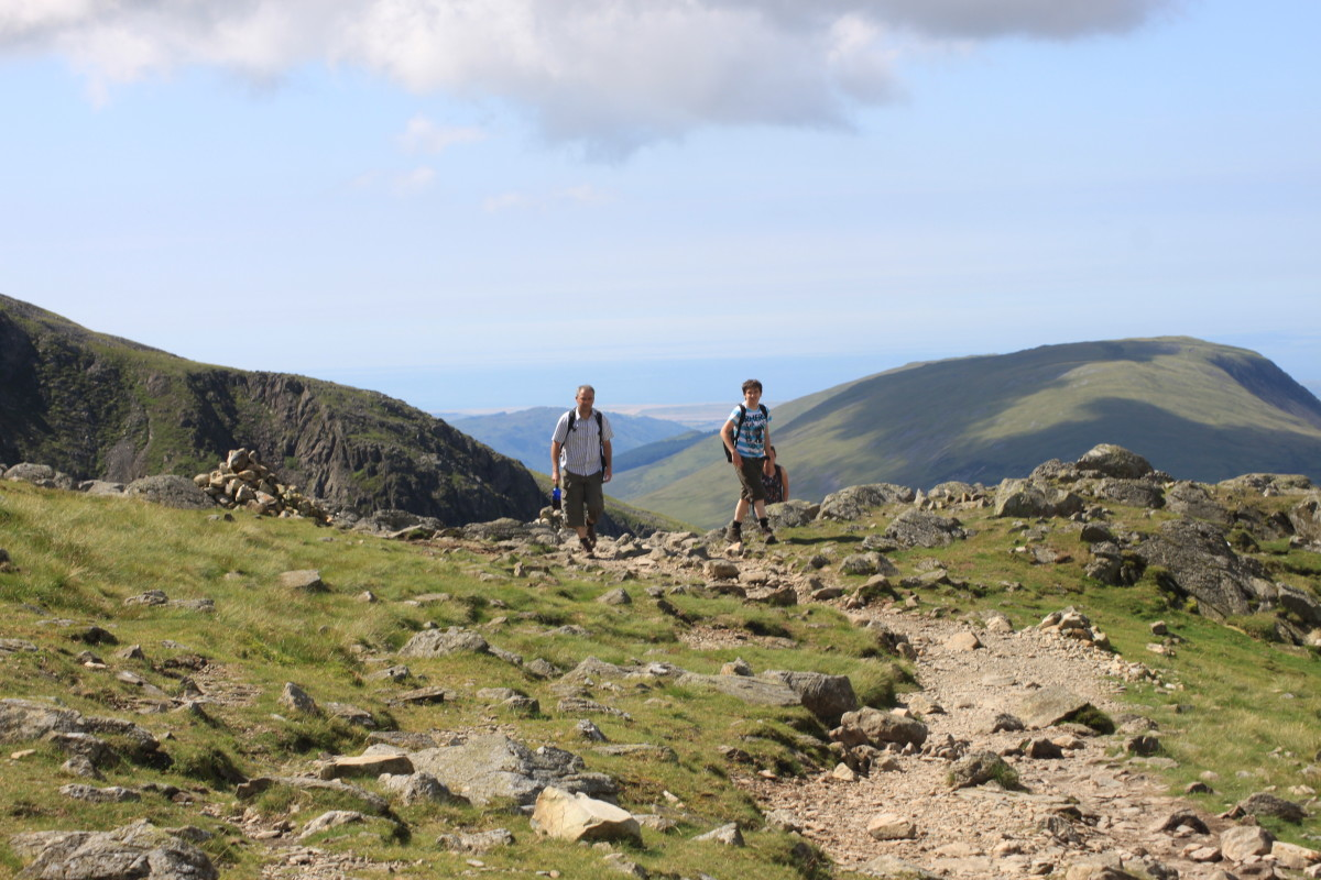 You're never alone on Scafell- Plenty of walkers out on a good day. (To the left of the photo is the edge towards the Peak of Sca Fell which isn't to be confused with Scafell Pike- it's a different mountain)