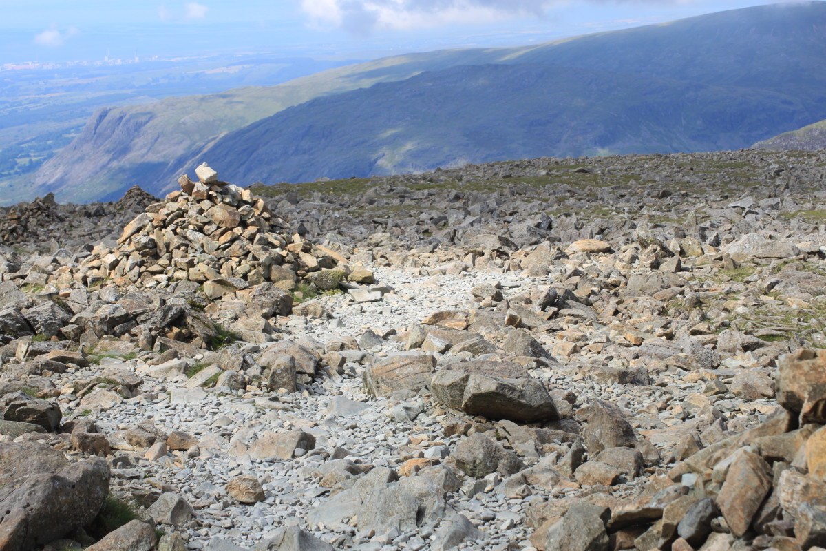Heading back down following the cairns with breathtaking views of the Lakeland Fells