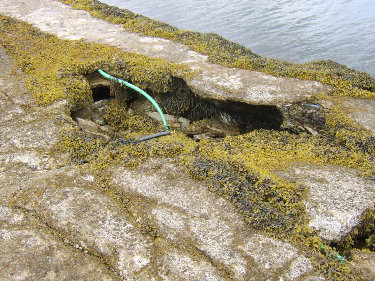 A large hole in the jetty at St Catherines, Loch Fyne