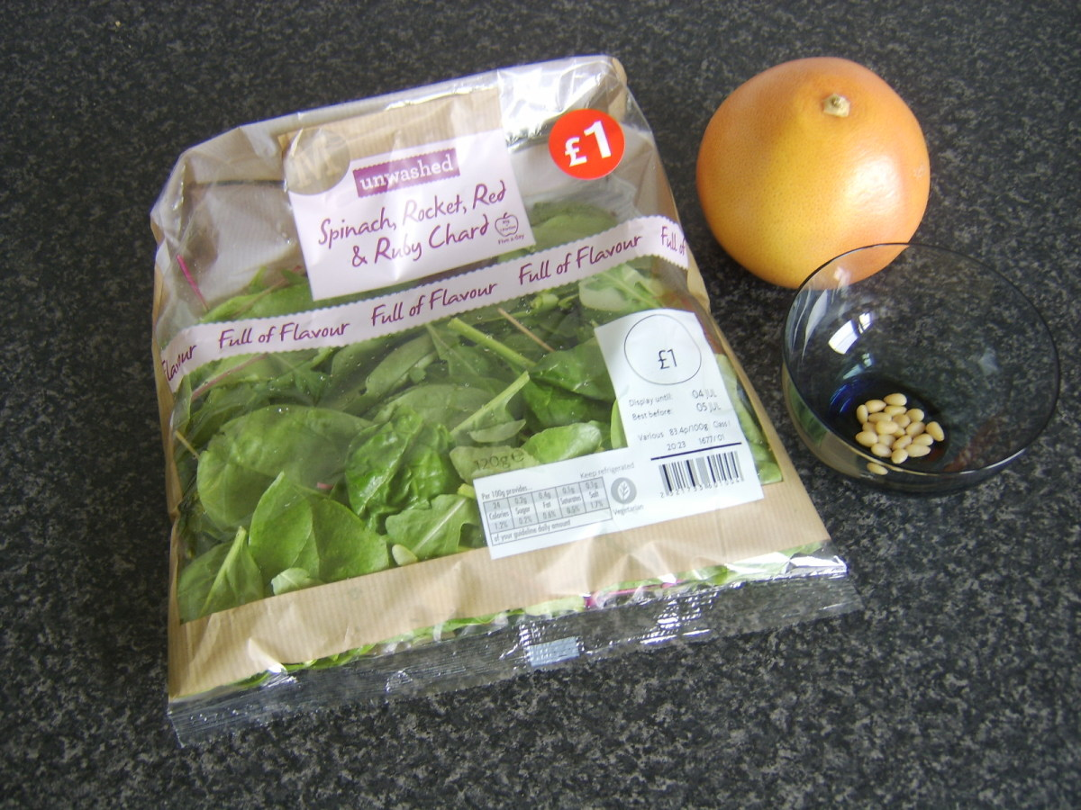 Mixed salad leaves of choice, red grapefruit and toasted pine nuts form a very simple but tasty salad