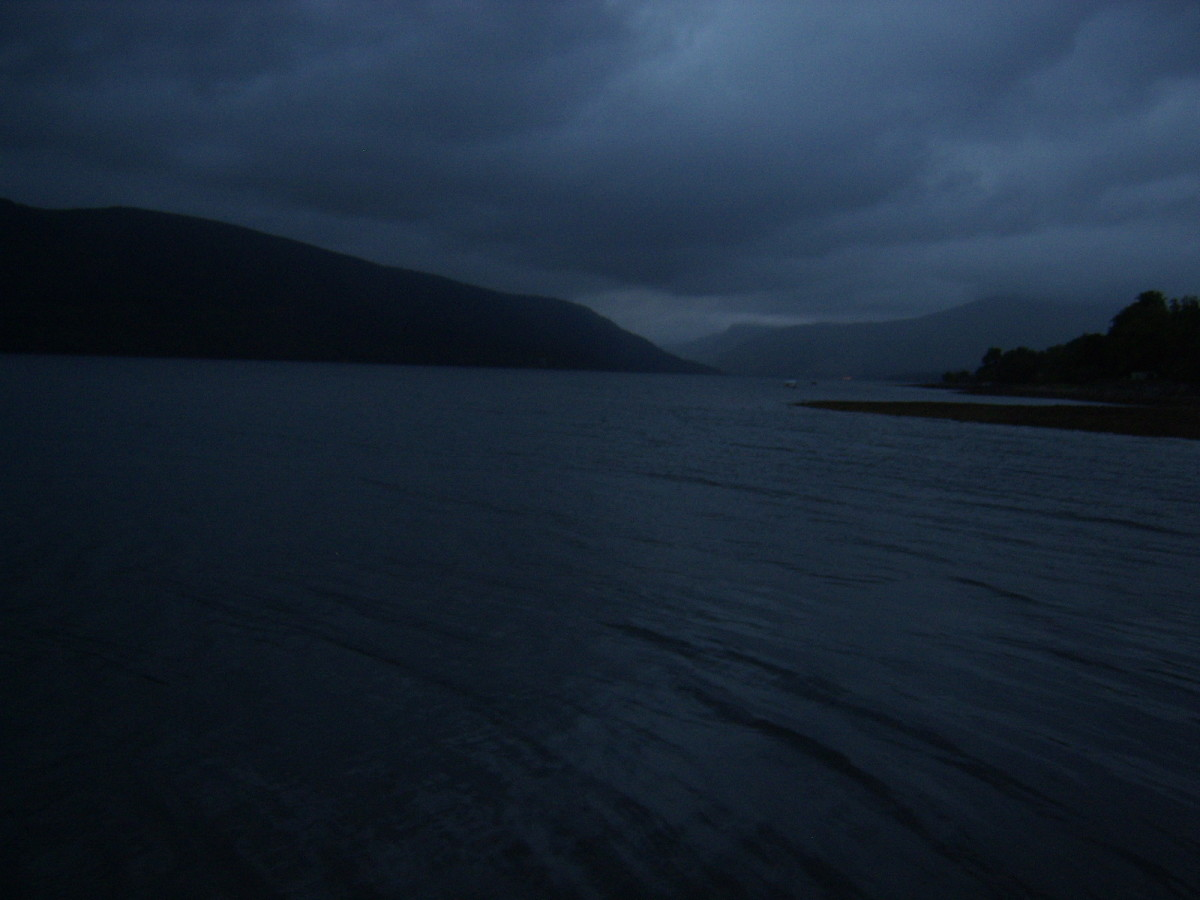 It is a very gloomy and overcast morning as dawn approaches at St Catherines Jetty, Loch Fyne