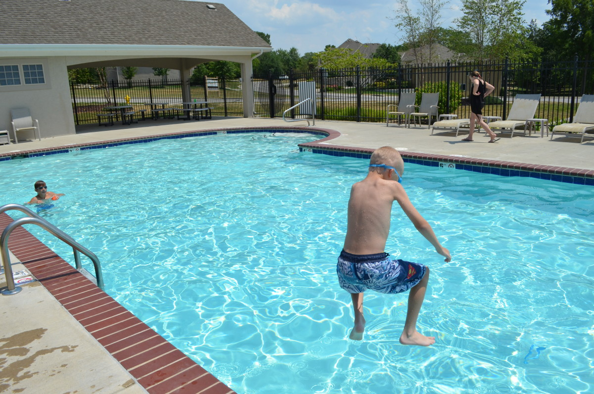 Child jumping into pool