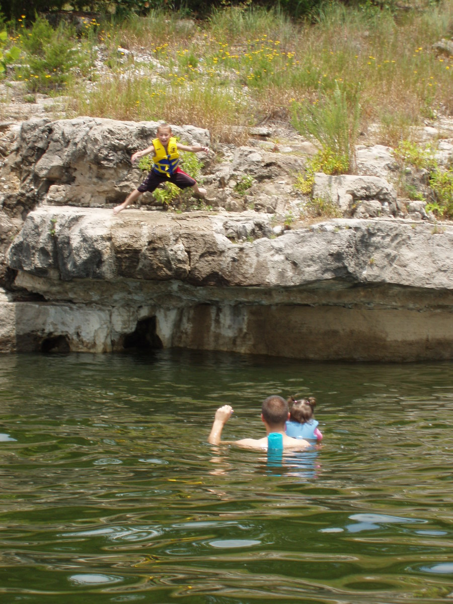 6 year old child jumping off cliff