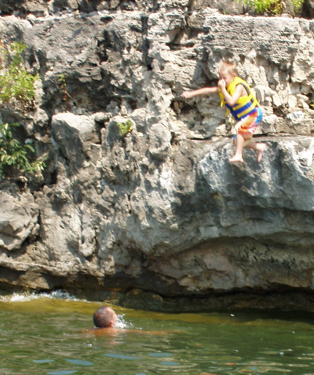 4 year old child jumping off cliff
