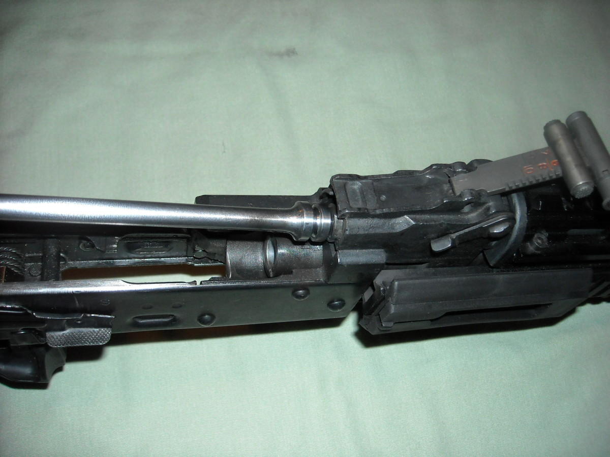 While holding the bolt carrier group in your hand, insert the gas piston end of the bolt carrier group into the gas piston chamber.