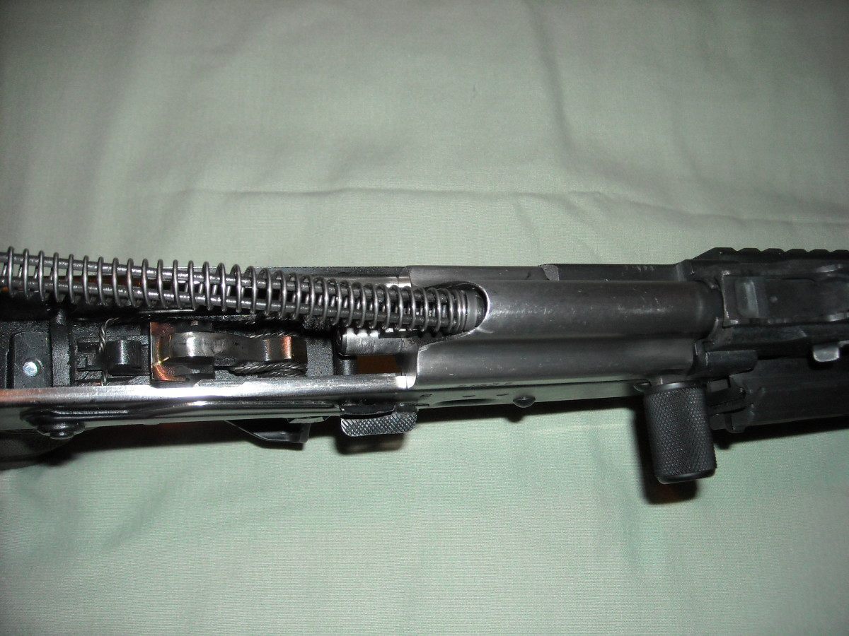 Insert the buffer spring assembly into the rear opening of the bolt carrier group.