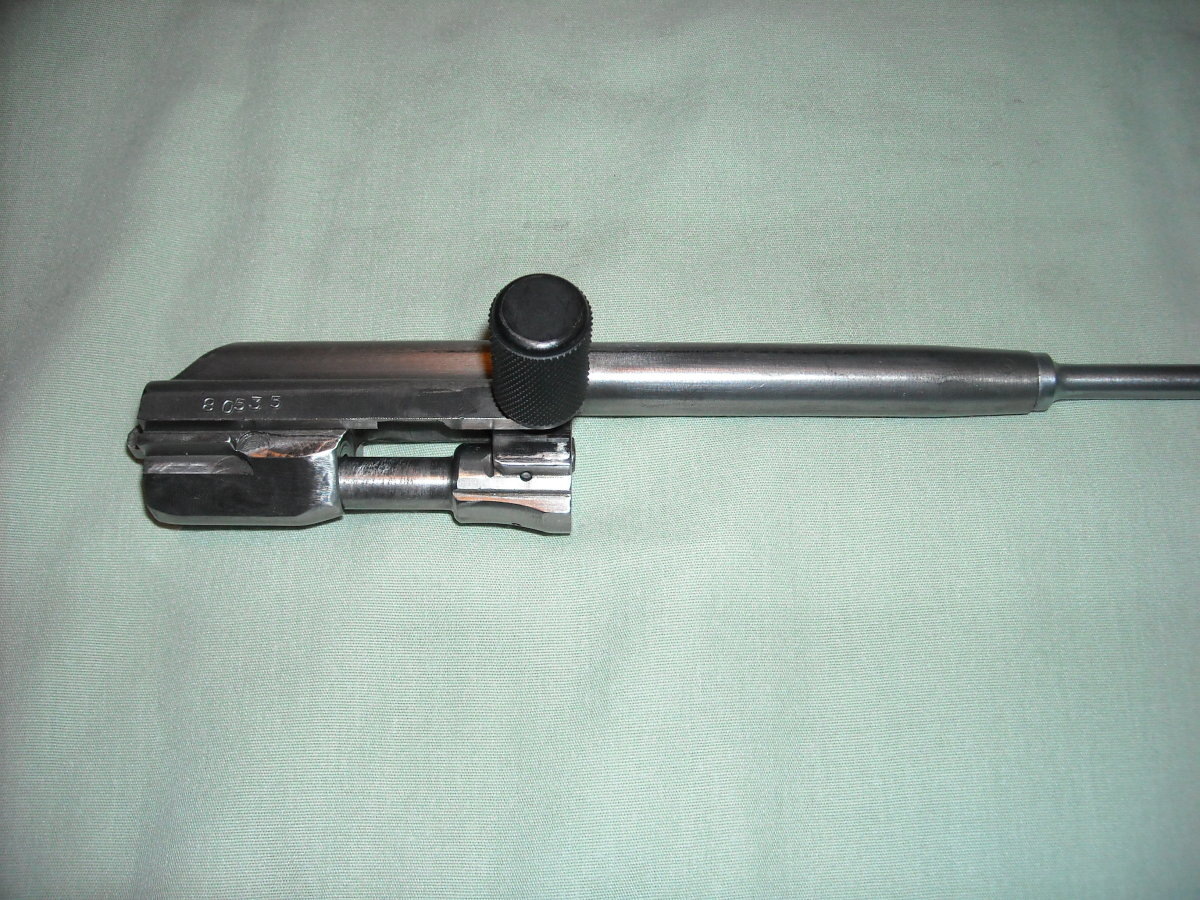 This is a fully re-assembled bolt and bolt carrier group. You will re-insert this group back into the receiver this way.