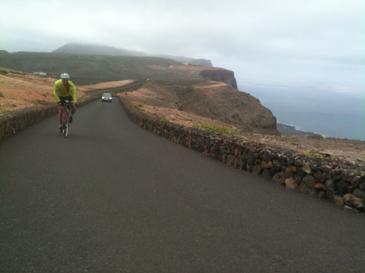 A cyclist climbing the Mirador Del Rio. The rugged yet beautiful Mirador Del Rio climb offers amazing views to La Isla Graciosa