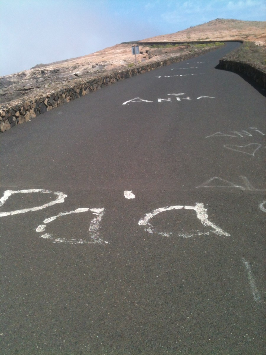 The climb to the Mirador Del Rio features in Ironman Lanzarote and specators write words of encouragement on the roads to inspire racers