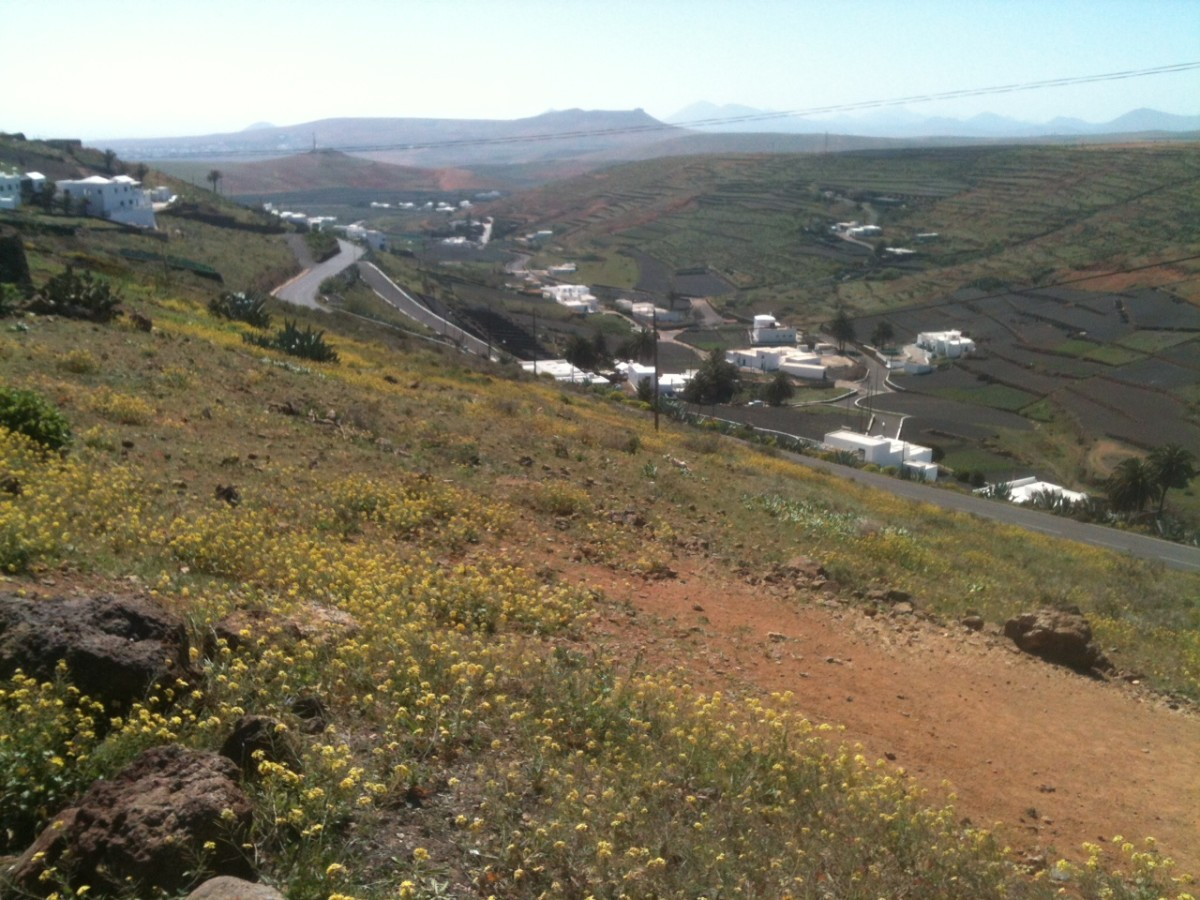 Looking back down the Los Valles Climb Towards Teguise and the Castillo Santa Barbara atop Guanpay in the distance.. The Los Valles Climb features in the Ironman Lanzarote Bike Course