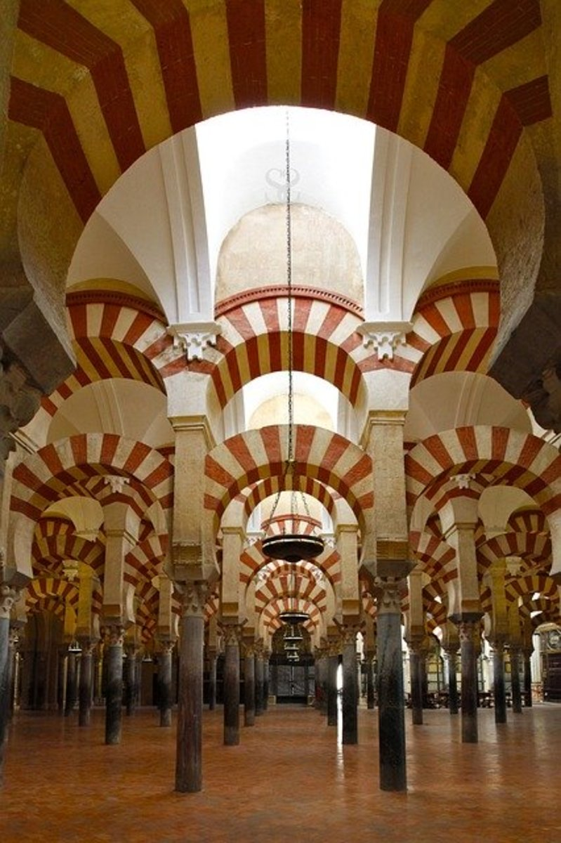 Interior of an Islamic mosque.  Rather than showing depictions of prophets and people, Islam tends to use patterns and quotes from the Koran for decorating its religious sites.
