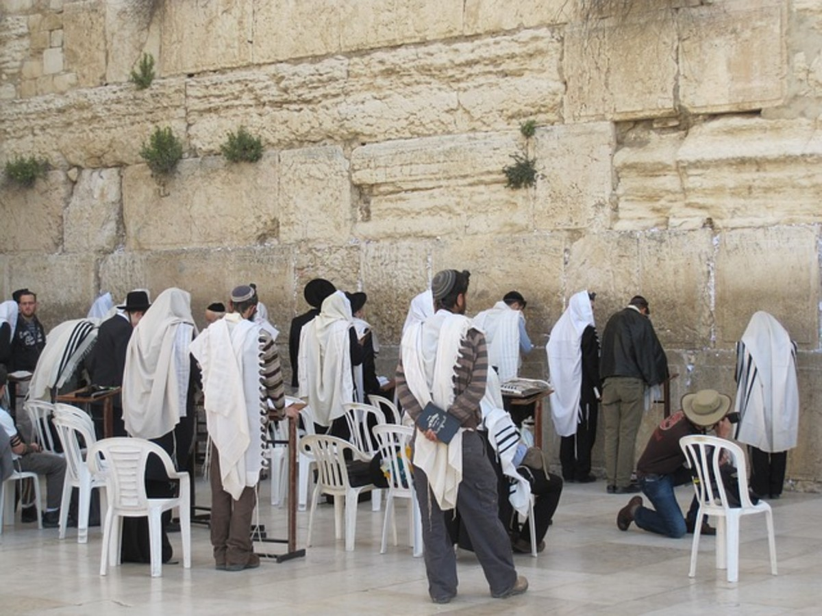 The Wailing Wall in Jerusalem, a sacred place for religious Jewish people.  The wall is thought to be the last remaining part of the Jewish Temple, which was destroyed 2000 years ago by the Romans.