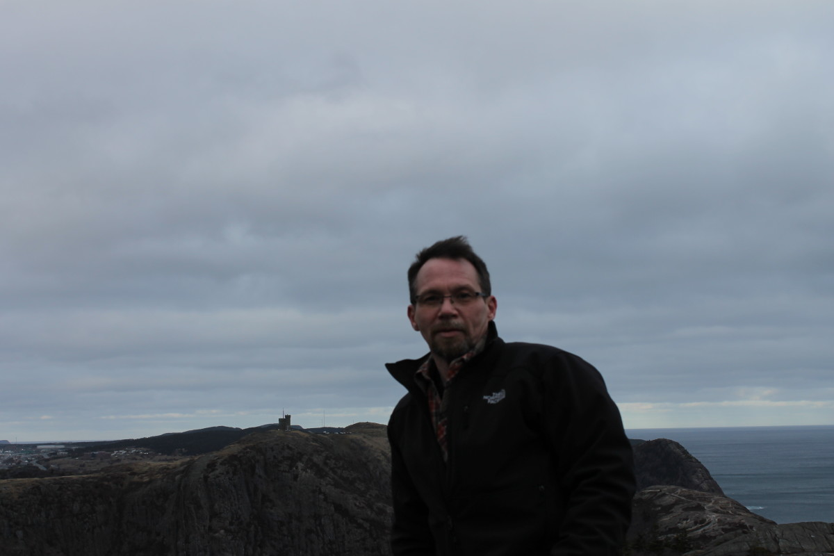 The author on Deadmans Bay Path at Soldiers Pond on the East Coast Trail. Cabot Tower, on Signal Hill, is just visible in the background.