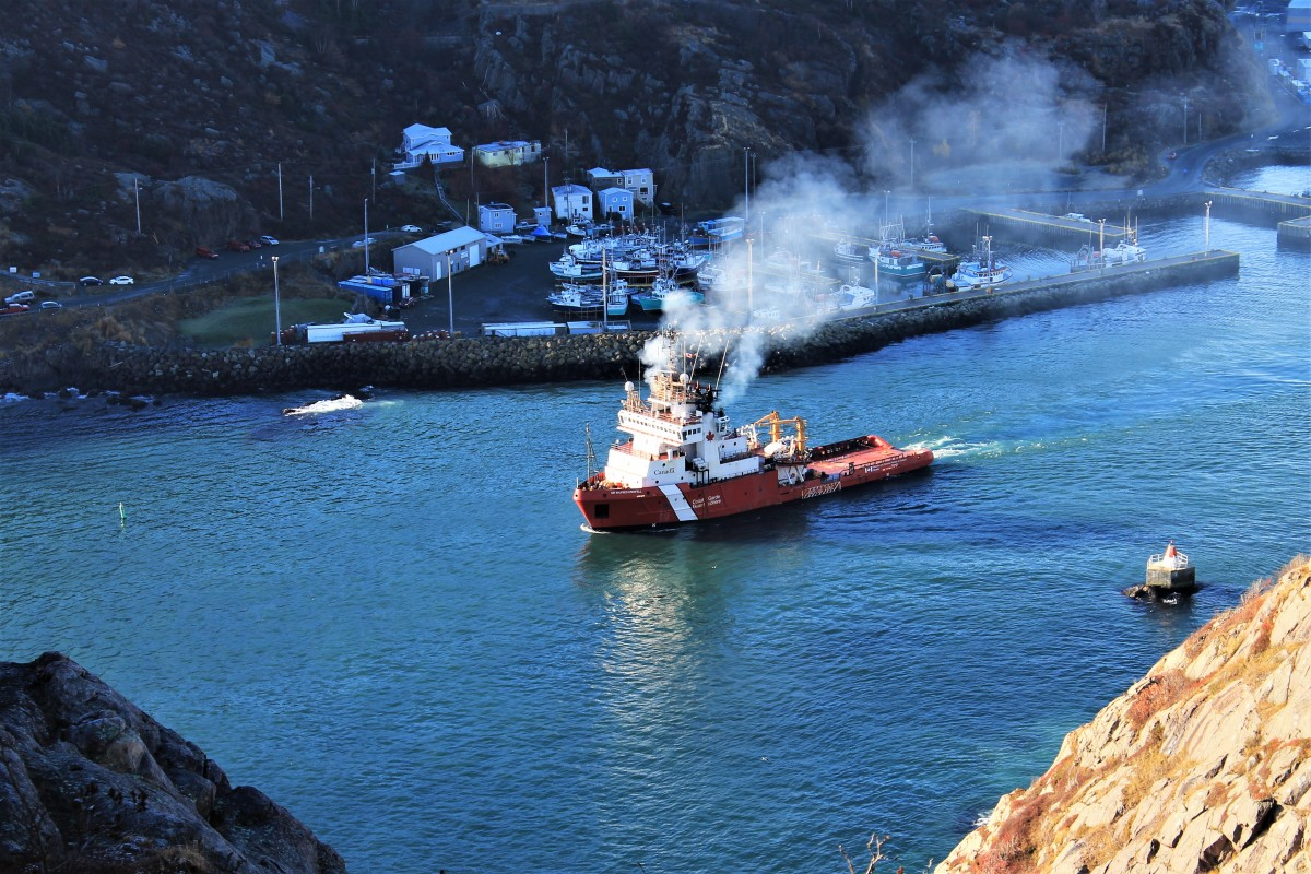 Looking Down From the Centre to Citadel Trail at a Coast Guard Vessel Passing Out Through the Narrows, St. John's Harbour.