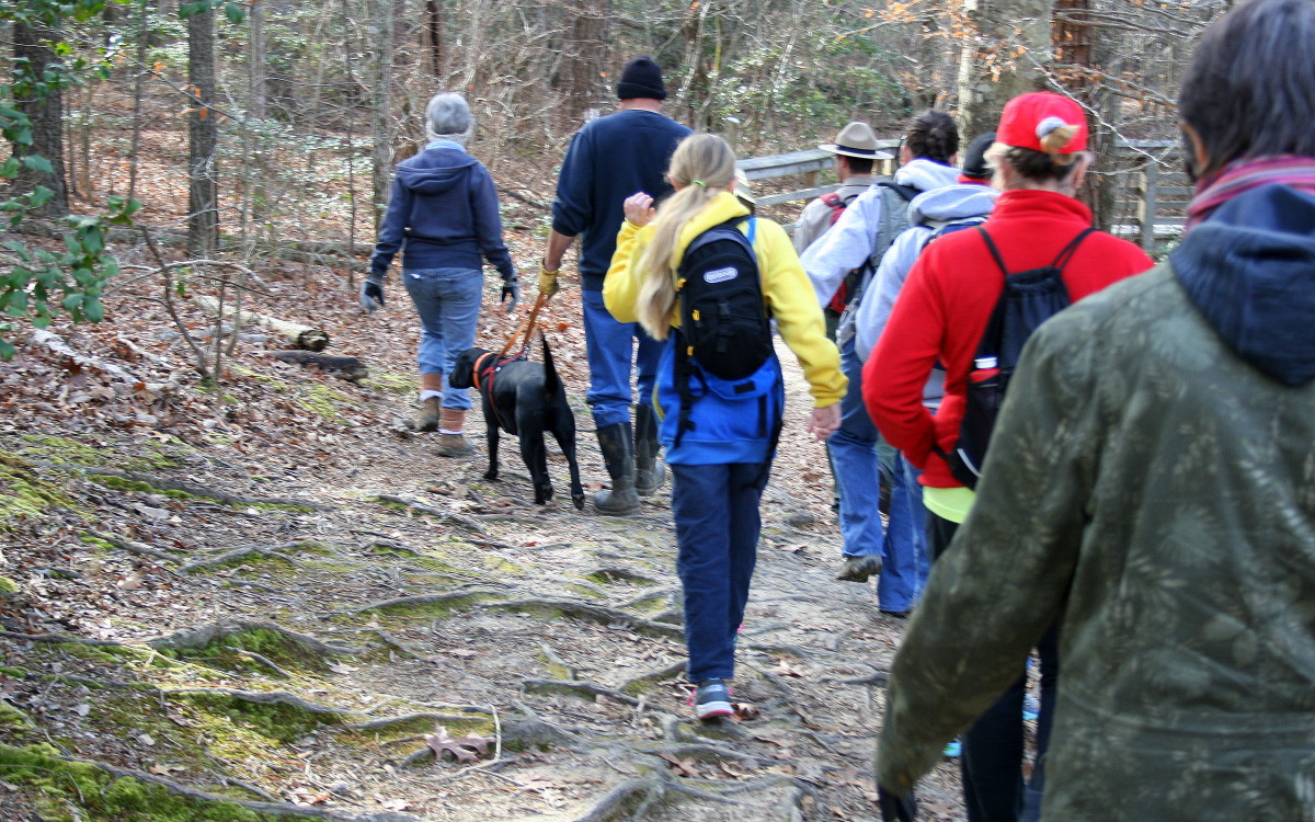 "A group of hikers in St. Mary's County, MD, take  ""First Day"" Hike at St. Mary's River State Park on New Year's Day 2017."