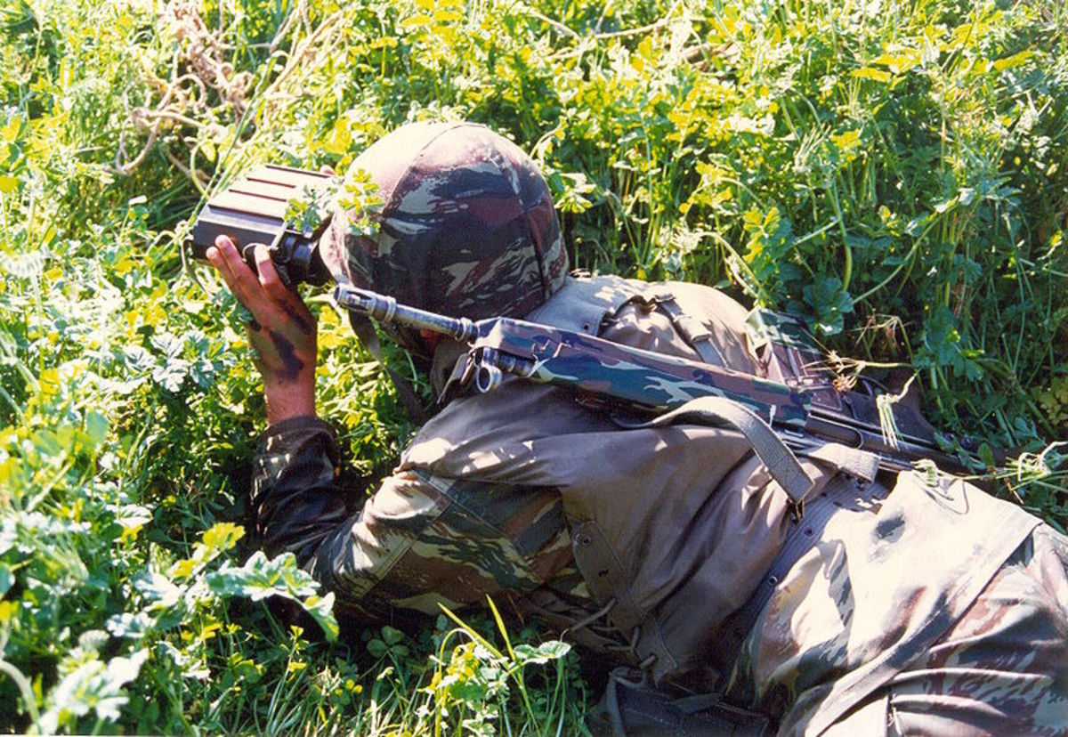 Soldier Using A Laser Range Finder