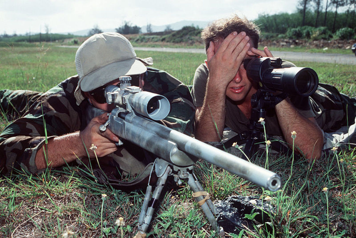 SEAL Sniper Team.  Note Specialized, Heavy Barrel Rifle With Long Range Optical Sight , Bipod, Rear Sand Bag Rest, Spotting Scope, and Spotter