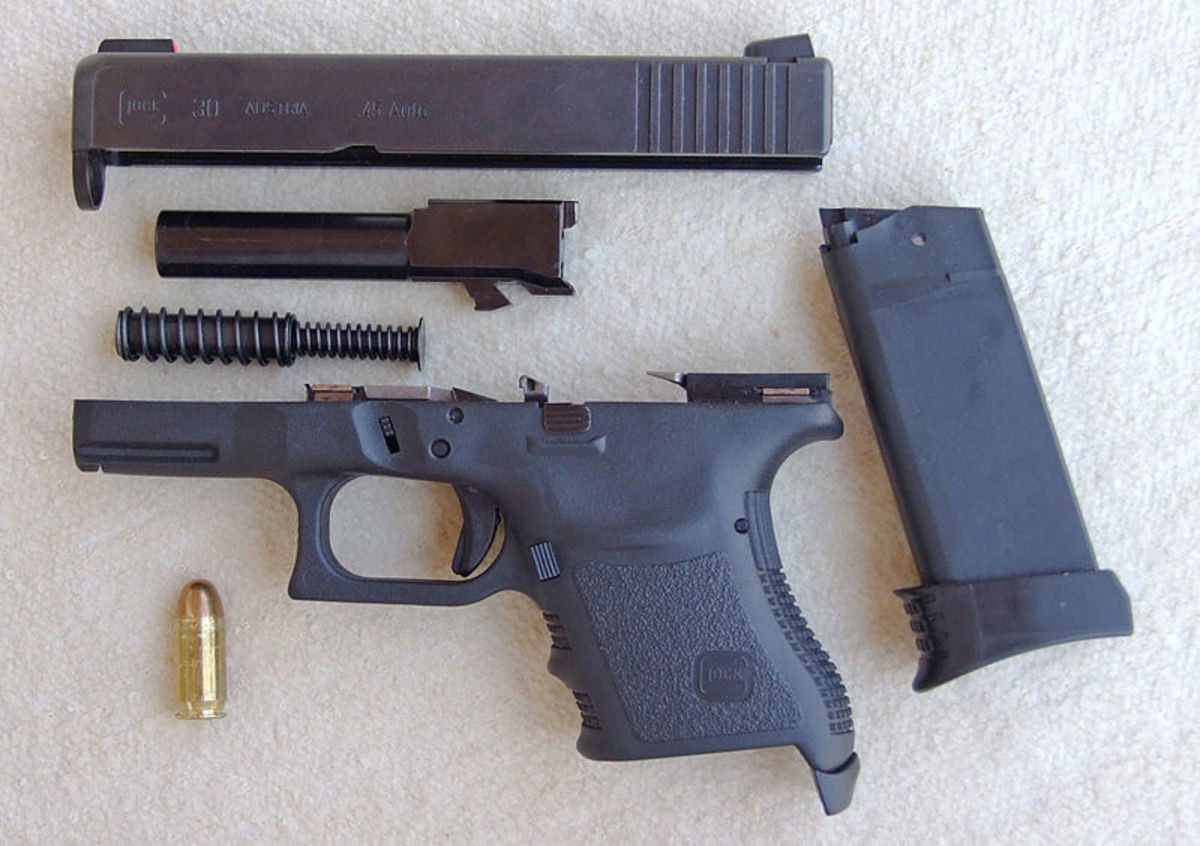 Glock Field Stripped.  Note Fewer And Simpler Parts; P-35 Style Under Barrel Cam And Barrel Feed Ramp