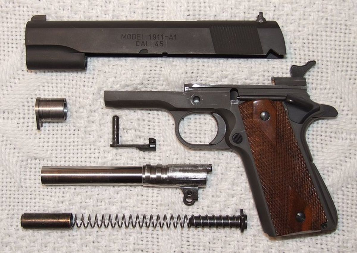 1911 Field Stripped.  Note Barrel Lugs And Swinging Link.  Link Cross Pin/Slide Release Is Above Barrel.