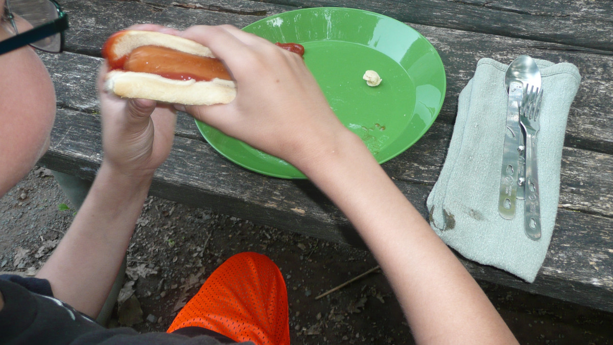 Each camper has their own mess kit and cloth napkin to reduce waste generated at the campsite.