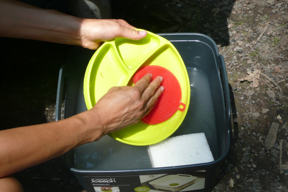 When camping, clean dishes with as little soap as possible, and use eco-friendly soap.