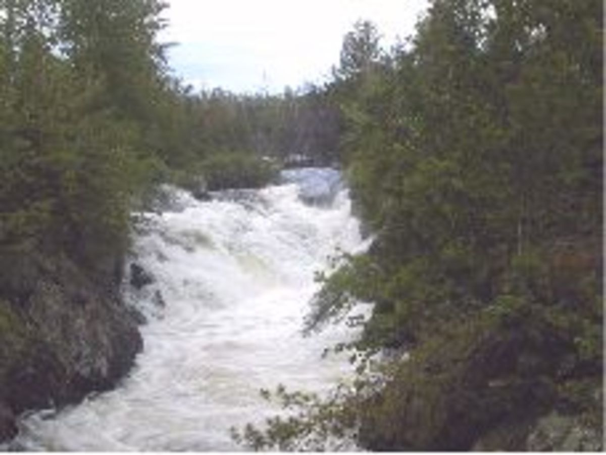 A thundering waterfall at the Agamok River Gorge