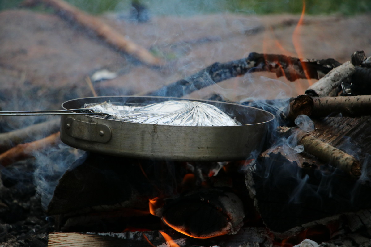 Cook simple meals when camping with little ones. Mountain pies, grilled cheese sandwiches, and pasta are easy to make and have an easy clean-up when mealtime is done.