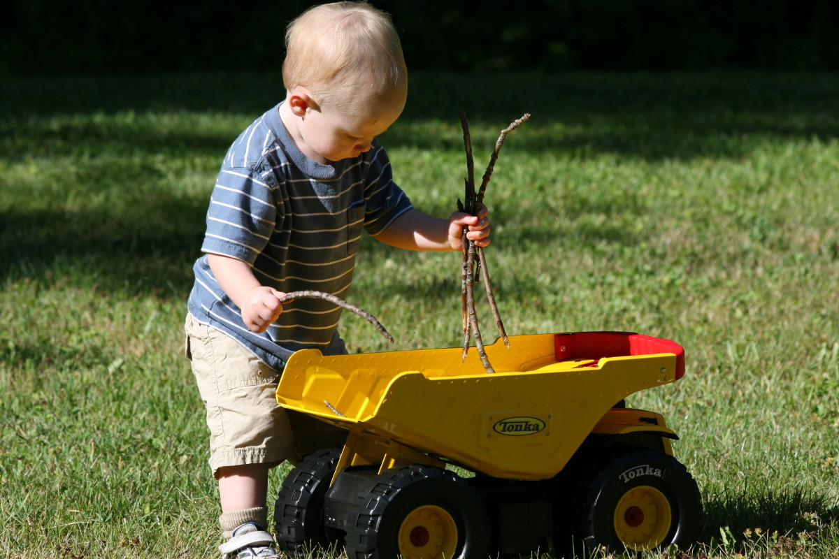 Toy cars and trucks are excellent toys at the campsite. Toddlers love filling the trucks with sticks, rocks, and other items they find in nature.