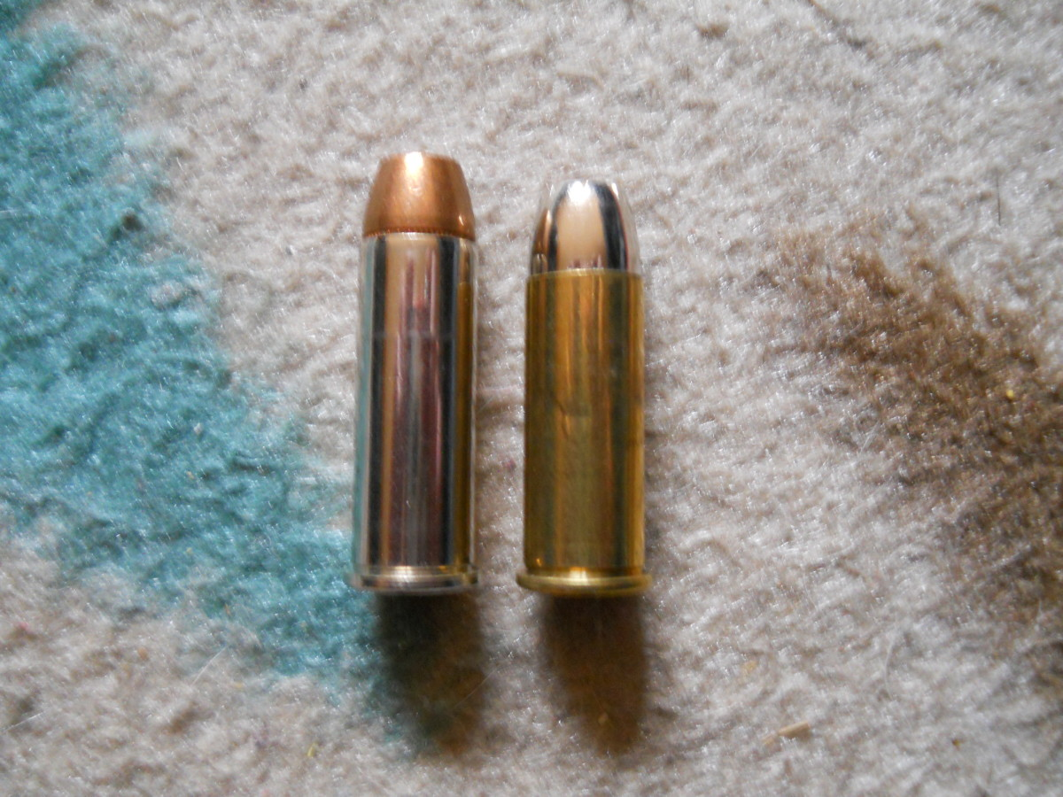 .44 Remington Magnum (left) next to its parent, the .44 S&W Special.  Elmer Keith developed the .44 Magnum by increasing the .44 Special's pressures.