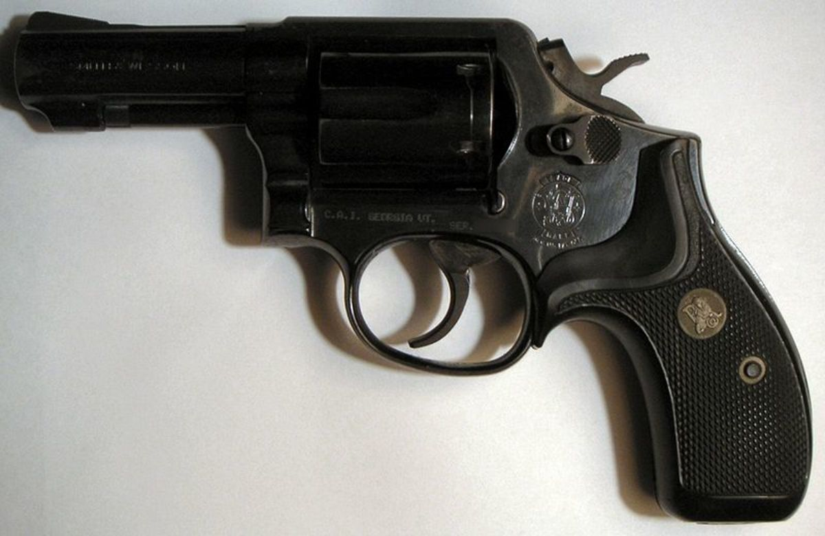 Author's choice for best all-round carry revolver: fixed sight, 3-inch S&W K-Frame such as the stainless Model 65 or blued Model 13 (shown).  Note full-length ejector rod and compact grips.