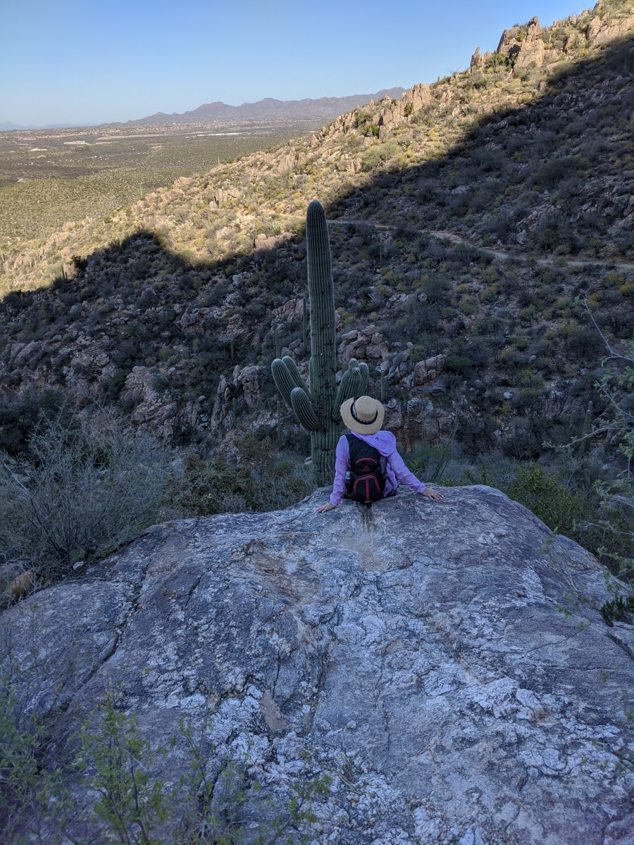 My wife maintaining social distancing while hiking to Romero Pools in Tucson Arizona's Catalina State Park