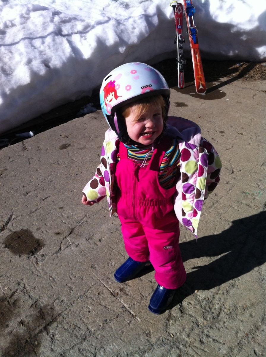 Child in ski helmet, bibs and jacket
