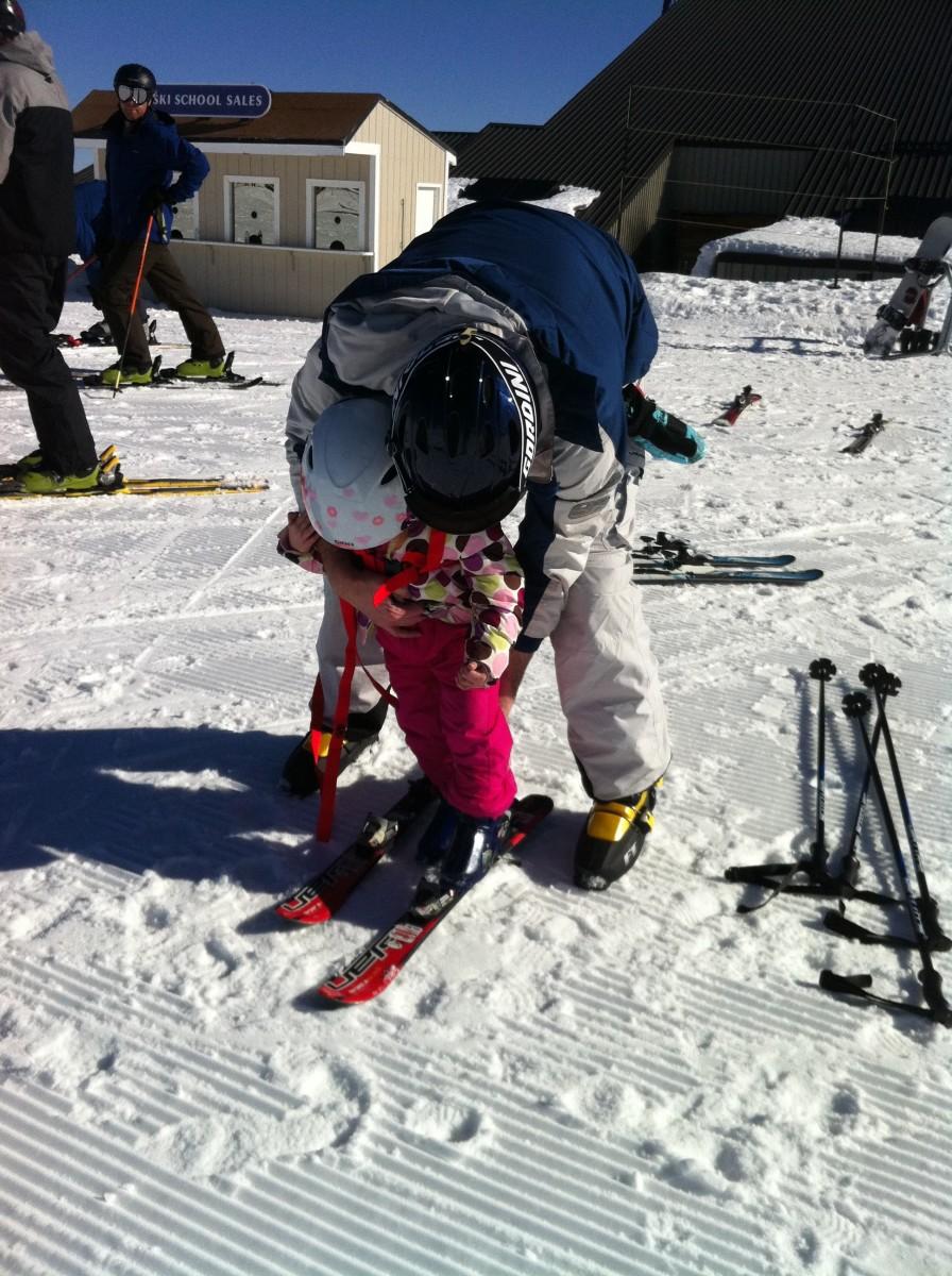 Putting on child skis