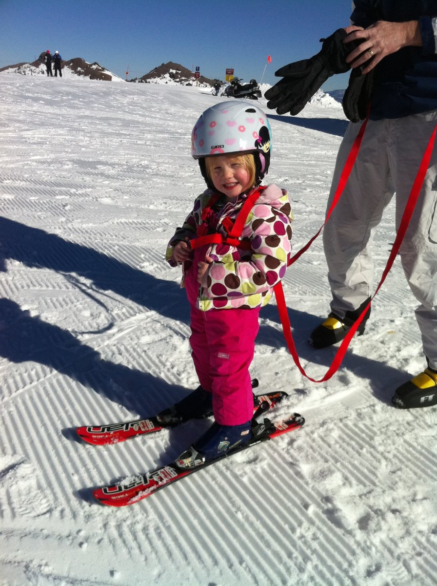 Three-year-old on ski harness.