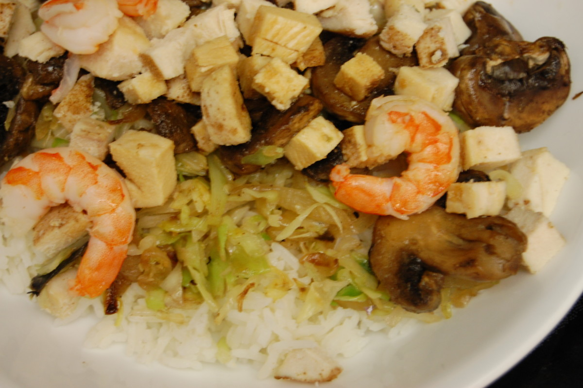 Stir-fry with chicken and shrimp over rice