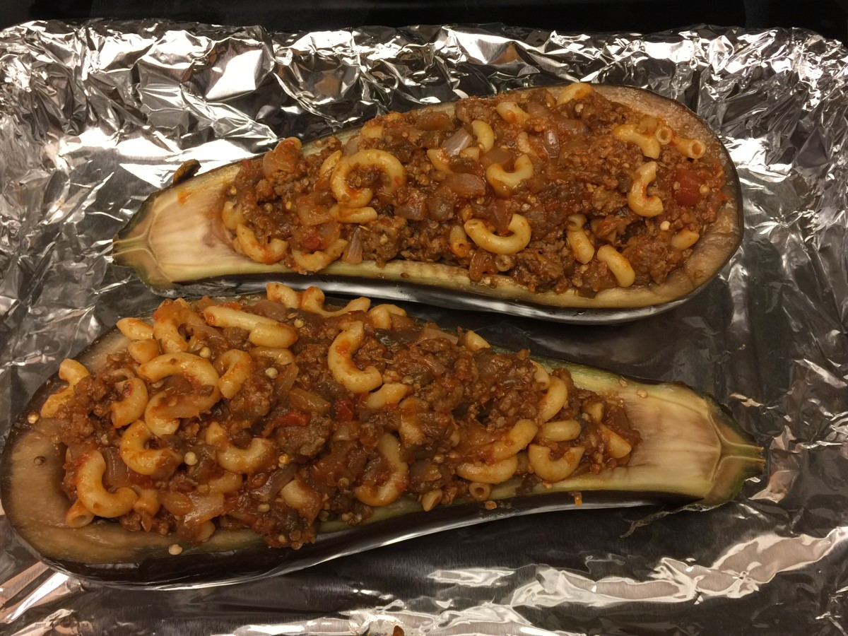 Spoon meat-macaroni mixture into eggplant halves