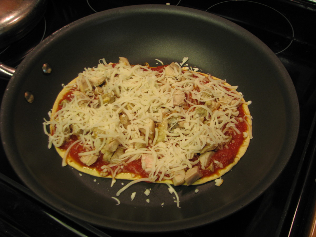 Skillet pizza is easy, fast and healthy with low fat multigrain wraps, tomato sauce, chicken and no-fat cheese.