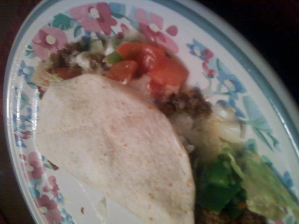 A soft taco including ground beef, cheese, tomatoes, lettuce, green peppers and onion. This whole taco can go right into the blender for an easy, tasty, blended meal.