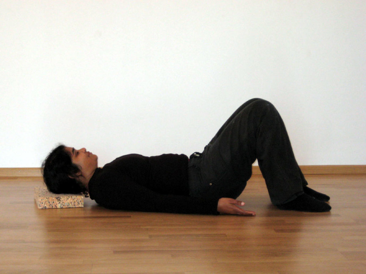 Relax on the floor to loosen up the knots in the neck.
