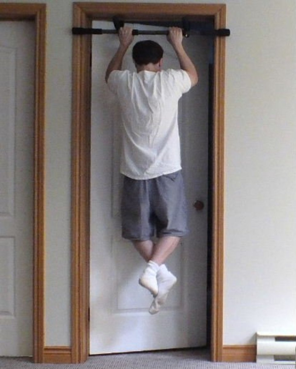 Using a pull up bar to do pull ups inside.