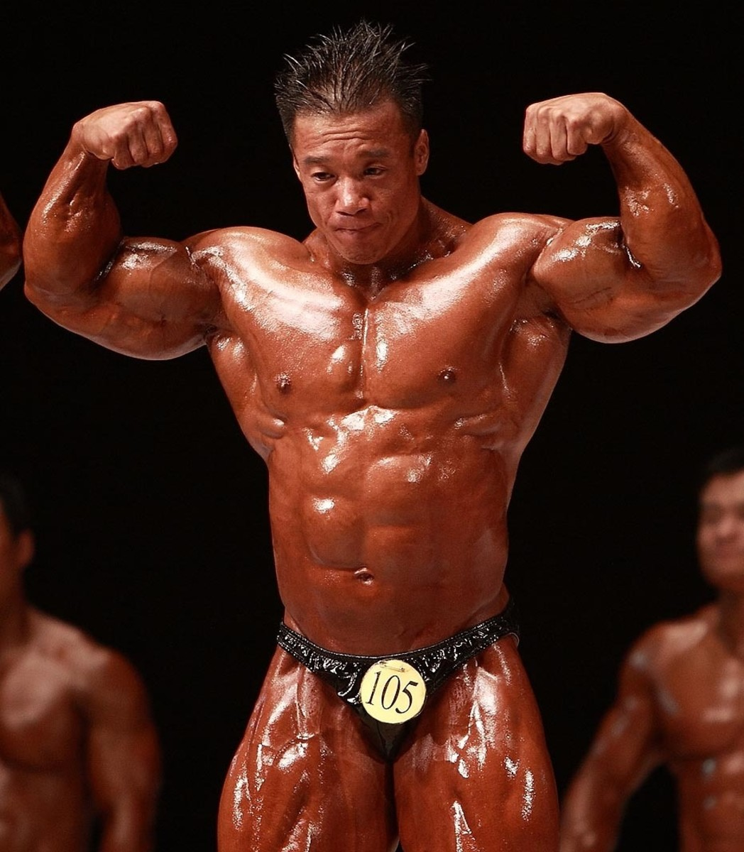 Korean bodybuilder Park Ki Seok (박기석) doing a double biceps pose at the 2009 National Sports Festival